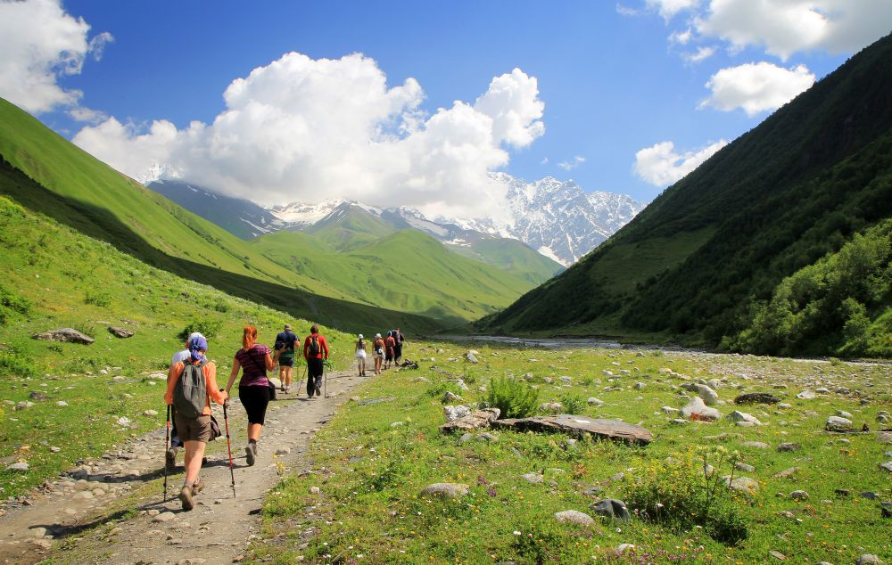 Group of tourists hiking in mountains